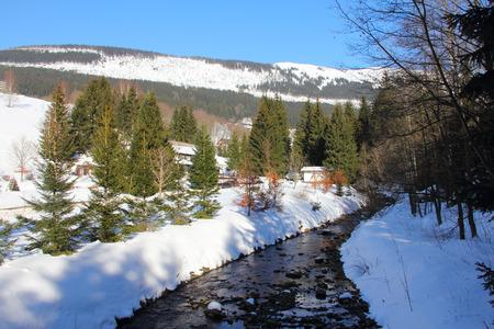krkonose: Winter landscape with forest and river in Spindleruv Mlyn, Krkonose, Czech Republic