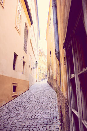 stare mesto: Narrow pedestrian alley between tenement houses in Prague. Stare Mesto. Old town.