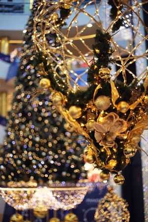 gold tree: Golden decorative christmas baubles on christmas tree background Stock Photo