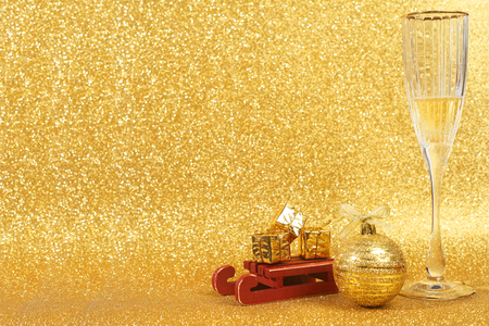 new year: Two glasses of champagne with golden glitter lights on background Stock Photo