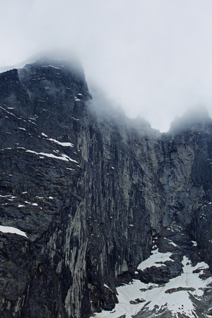 troll: The Troll Wall in Norway, magestic summer foggy mountains Stock Photo