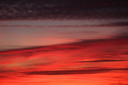 misterious: Beautiful dramatic sunrise with red clouds in sky Stock Photo