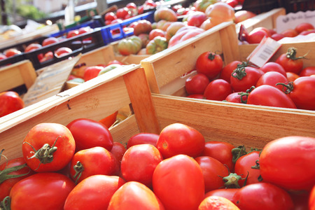 fruits in a basket: Tomatoes at farmers market close up Stock Photo