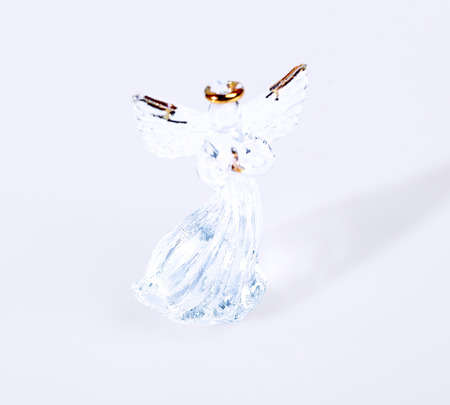 crystal background: Crystal angel figurine on white background Stock Photo