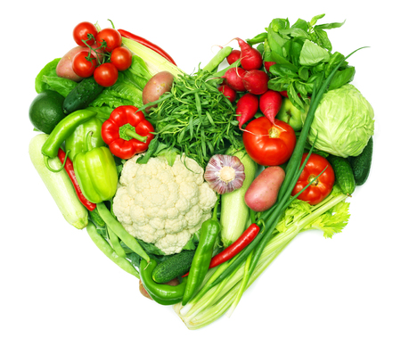 Love vegetables concept, pile of vegetables shaped as heart isolated on white background Reklamní fotografie
