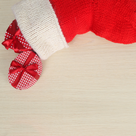 christmas sock: Red Christmas sock isolated on wooden background