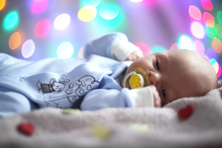 miraculous: Love newborn baby Valentines day concept woth gearts and bokeh lights Stock Photo