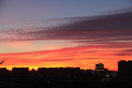 misterious: Beautiful dramatic sunrise with red sky the city