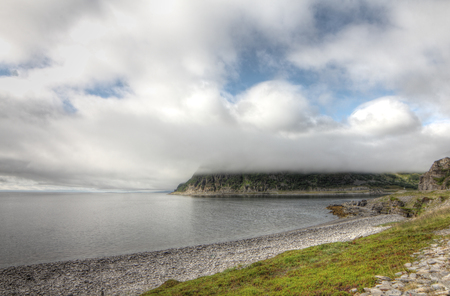 Norwegian fjord and mountains in cloudy weather Stock Photo