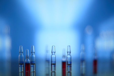 ampoule: Medical syringe and vials on table in hospital