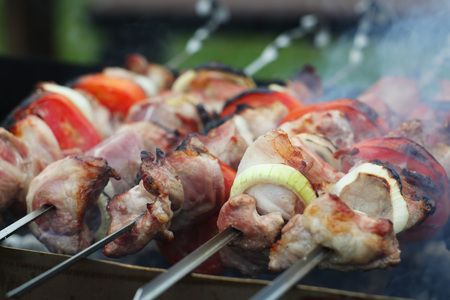 Grilling shashlik on barbecue grill, selective focus