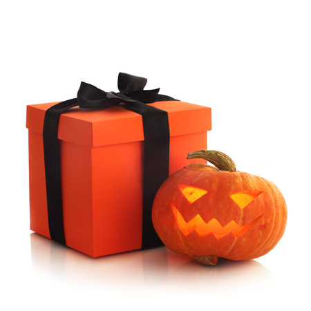 Halloween pumpkin and gift isolated on white background
