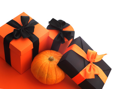 Halloween pumpkin and gifts isolated on white background, corner composition with copy space Stock Photo - 82401948