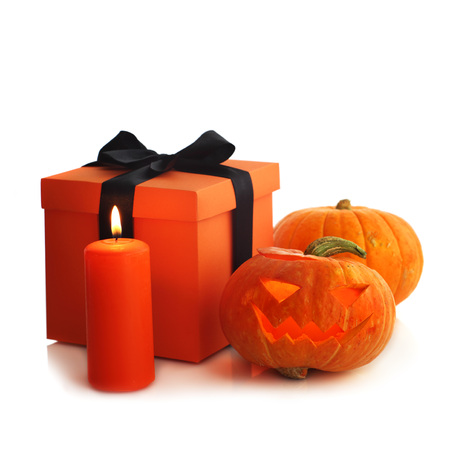 Halloween pumpkin and gifts isolated on white background Stock Photo