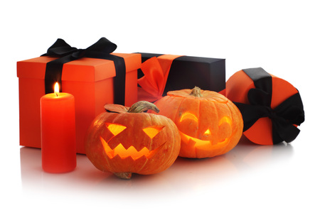 Halloween pumpkin and gifts isolated on white background, corner composition with copy space Stock Photo