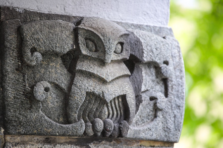 Decorative owl element in old stone building in Bergen, Norway 스톡 콘텐츠