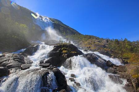 View on Langfossen Langfoss waterfall in summer, Etne, Norway 写真素材