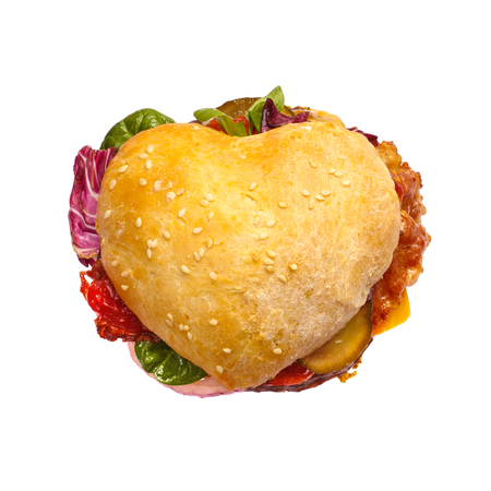 Heart shaped hamburger, love burger fast food concept, isolated on white background, top view