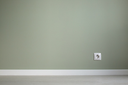 Empty wall and floor background of scandinavian room interior with white plinth and socket close up , copy space for text , renovation , new home ownership concept