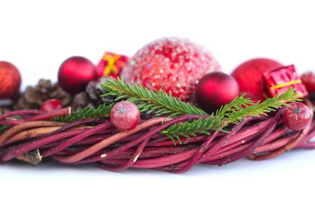 Christmas wreath of fir tree branches decorative beaubles and red berries isolated on white background copy space for text