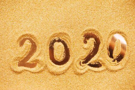 Hand drawn2020 Happy new year symbol on golden glitter background Stock fotó