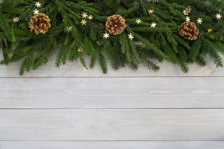Christmas new year flat lay decor and fir branches on white toned natural wooden plank background texture provence style with copy space for text