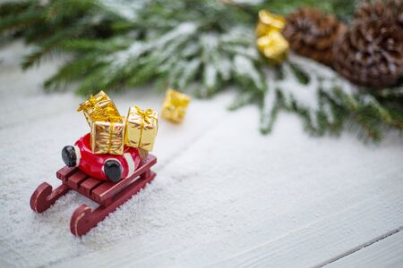 Santa Claus sledge accident in snow with lost gifts around