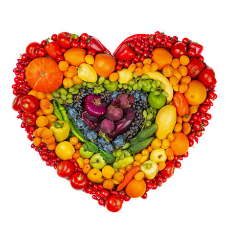 Rainbow heart of fruits and vegetables studio isolated on white background go vegetarian love healthy eating concept