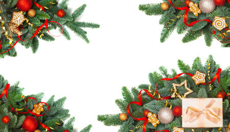 Christmas design boder frame greeting card of noble fir tree branches and red golden baubles isolated on white background corner copy space for text Reklamní fotografie