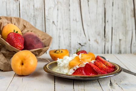 Cottage cheese for breakfast with fruit and strawberries. Healthy eating Stock Photo