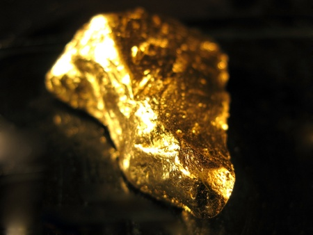 nugget: gold on a black background Stock Photo