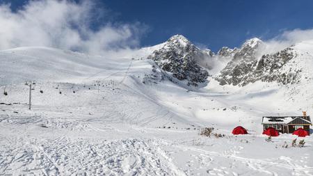 Lomnicky stit peak winter panorama. Skalnate sedlo ski resort, Slovakia