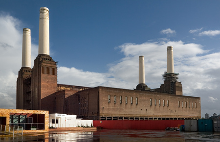 London, United Kingdom - October 01, 2006: Empty reception and entrance of decommissioned (in 1983) coal Battersea power station with one of iconic four white chimneys being fixed on a sunny day.