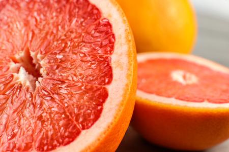 Detail of red grapefruit cut in half.