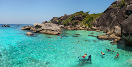 Similan Islands, Thailand - February 23, 2016:  Tourists snorkeling, swimming and enjoying crystal clear water in Similan Islands during guided tour on a sunny day.