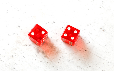 Two red craps dices showing Easy Six Jimmie Hicks number 2 and 4 overhead shot on white board
