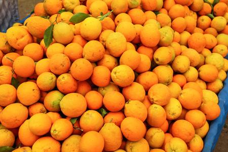 Pile of oranges displayed on food market.