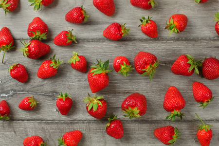 Tabletop view - ripe strawberries, freshly picked, on gray wooden boards. 写真素材