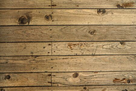 Top down view - old wooden floor texture, tiles secured with nails.