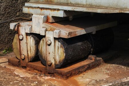 Rollers at the end of the railway bridge, for thermal expansion compensation.