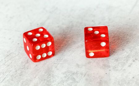 Two translucent red craps dices on white board showing Easy Eight number 5 and 3 写真素材