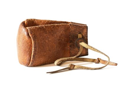 Old worn leather coin pouch isolated on white background