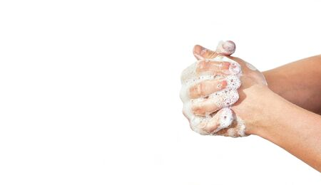 Young man wash hands with soap, closeup detail on soap bubbles, isolated on white, space for text left side. Can be used during coronavirus covid-19 outbreak prevention