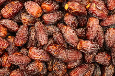 Dates (date palm fruits) displayed on food market.