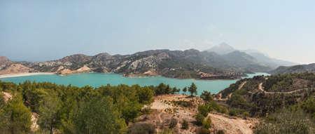 Panorama of Gecitkoy (Dagdere) dam with turquoise water near Kyrenia, Northern Cyprus.