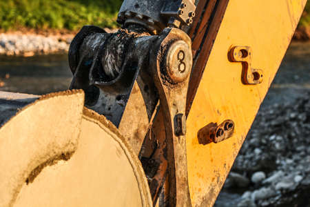 Detail of excavator (digger machine) bucket joint mechanism. Abstract image to illustrate construction.