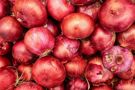 Top view, red onions displayed on food market in Kyrenia, Cyprus.