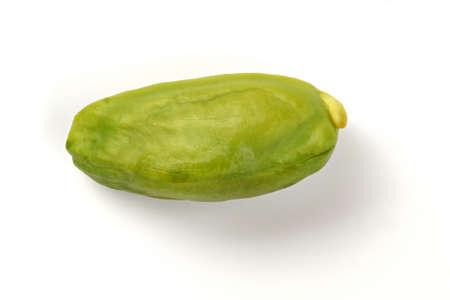 Single green pistachio nut peeled, isolated on white background. 版權商用圖片