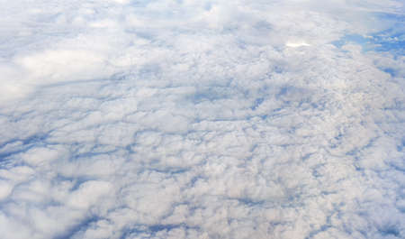 Fluffy clouds that looks as flat surface as seen from commercial airplane 版權商用圖片