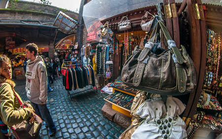London, United Kingdom - March 31, 2007: Extreme wide angle (fisheye) photo of bags, clothes and other accessories on display at Camden Lock, famous flea market in UK capital.